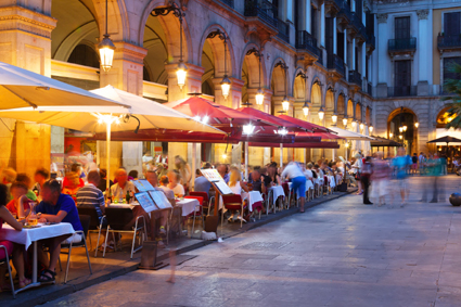 "After sunset, gather with friends in the plaza for ""un vaso de vino tinto"""