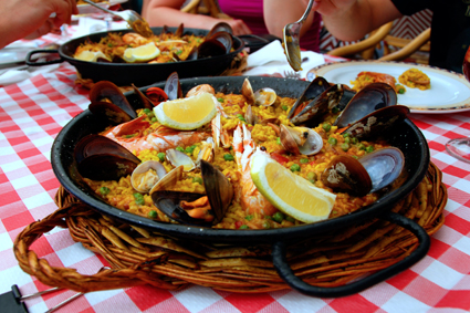Soak up the flavors of Paella: saffron, rosemary, olive oil, seafood!